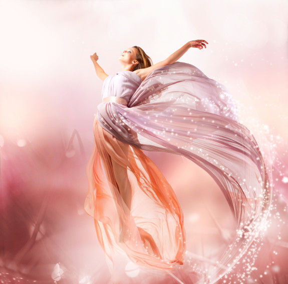 Fairy. Beautiful Girl in Blowing Dress Flying. Magic