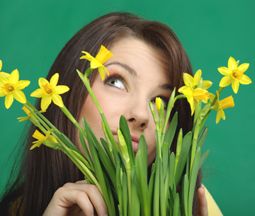 Beautiful  girl with yellow flowers. green background