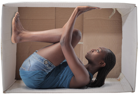 Young african woman stuck in a carton