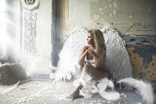 Romantic young beauty blonde woman as an angel